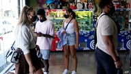 Shoppers wear masks inside of The Cool store Monday, July 19, 2021, in the Fairfax district of Los Angeles. Los Angeles County…