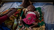 FILE - In this Tuesday, May 11, 2021 file photo, Abeba Gebru, 37, from the village of Getskimilesley, sits with her…