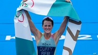 Flora Duffy of Bermuda celebrates after crossing the finish line to win the gold medal in the women's individual triathlon…