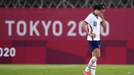 United States' Carli Lloyd leaves the field after being defeated 1-0 by Canada during a women's semifinal soccer match at the…