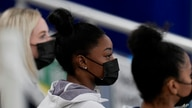 United States gymnast Simone Biles sits on the stands during the artistic gymnastics women's all-around final at the 2020…