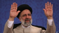 Iran's new President-elect Ebrahim Raisi waves to participants at the conclusion of his press conference in Tehran, Iran,…