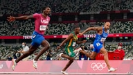 Lamont Jacobs, right, of Italy, wins the men's the 100-meter final at the 2020 Summer Olympics, Sunday, Aug. 1, 2021, in Tokyo…