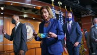 Speaker of the House Nancy Pelosi, D-Calif., leaves at the end of a news conference on priority issues, including voting rights…