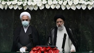 President Ebrahim Raisi, right, takes his oath as president, as Judiciary Chief Gholamhossein Mohseni Ejehi listens in a…