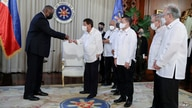 In this photo provided by the Malacanang Presidential Photographers Division, U.S. Secretary of Defense Lloyd Austin, left,…