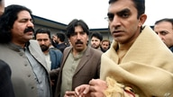 In this Jan. 27, 2020, photo, leaders of the Pashtun Tahafuz (Protection) Movement or (PTM), Mohsin Dawar, right, and Ali Wazir…