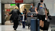 A woman runs to greet a child as passengers arrive at Terminal 5 of Heathrow Airport in London, Monday, Aug. 2, 2021. Travelers…