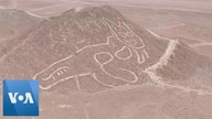 Drone Footage Reveals Ancient Cat Etched into Peru Hillside