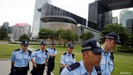 Police patrol outside the Legislative Council building in Hong Kong