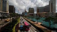 FILE PHOTO: Traffic flows past gaming resorts at Cotai Strip in Macau