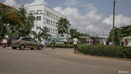 People are seen going into the National hospital after resident doctors commence a doctors strike, as coronavirus disease (COVID-19) infection continues to rise in Abuja
