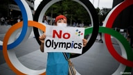 People protest against the Tokyo 2020 Olympic Games