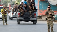 Afghan security forces transport detained prisoners who escaped from a jail after insurgents attacked a jail compound in Jalalabad