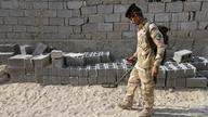 Iraqi security forces carry out a raid in Basra