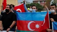 Demonstrators shout slogans during a protest against Armenia near the Consulate of Azerbaijan in Istanbul