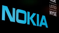 FILE PHOTO: The logo and ticker for Nokia are displayed on a screen on the floor of the NYSE in New York