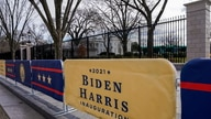 Signs for the inauguration of President-elect Joe Biden stand near the White House in Washington