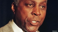 FILE PHOTO: Vernon Jordan speaks to reporters at a news conference