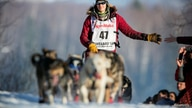 FILE PHOTO: Leifseth Ulsom of Norway heads up the first hill out of the start chute during the official restart of the Iditarod dog sled race in Willow, Alaska