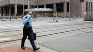 Minneapolis police officer walks past Hennepin County Public Safety Facility