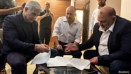 United Arab List party leader Mansour Abbas, Yamina party leader Naftali Bennett and Yesh Atid party leader Yair Lapid, sit together in Ramat Gan
