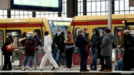 FILE PHOTO: Passengers wear face masks at Friedrichstrasse station during COVID-19 lockdown in Berlin