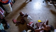 People shelter inside a school after their settlement was burned down by gangs in Port-au-Prince