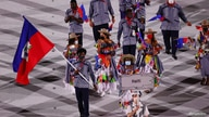 FILE -- Team Haiti participates in the athlete's parade at the Tokyo 2020 Olympics, July 23, 2021.