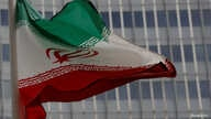 FILE PHOTO: An Iranian flag flutters in front of the International Atomic Energy Agency (IAEA) headquarters in Vienna, Austria…