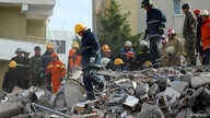 Emergency personnel work at the site of a collapsed building in the town of Durres, following Tuesday's powerful earthquake…