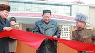 North Korean leader Kim Jong Un cuts a ribbon during a ceremony for the completion of the Yangdok County Hot Spring Cultural…