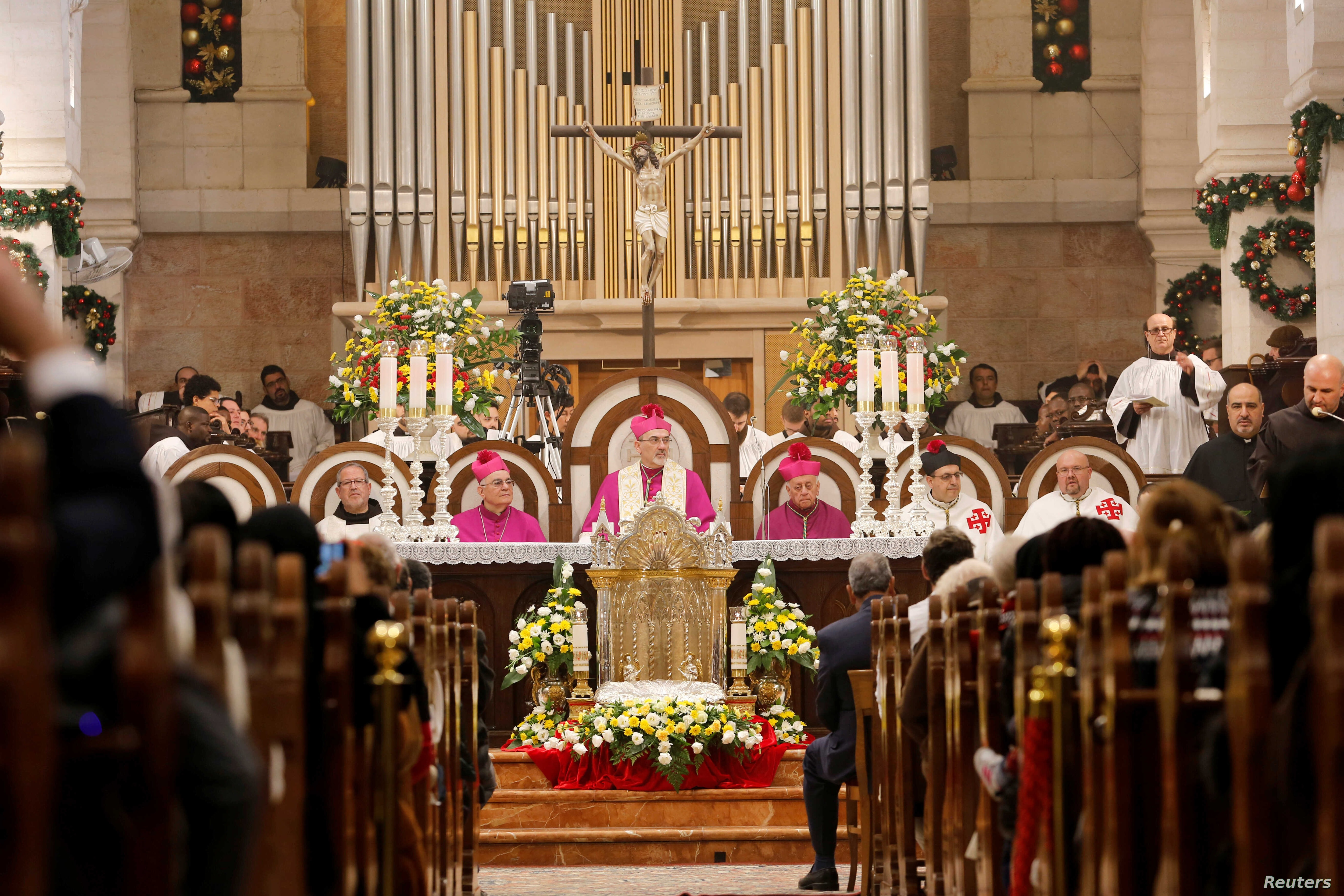 The acting Latin Patriarch of Jerusalem Pierbattista Pizzaballa leads a mass at the Church of the Nativity on Christmas eve in…
