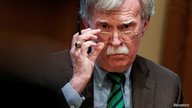 FILE PHOTO: National Security Advisor John Bolton adjusts his glasses as U.S. President Donald Trump speaks while meeting with…