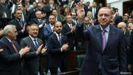 Turkish President Tayyip Erdogan greets members of his ruling AK Party during a meeting at the Parliament in Ankara, Turkey,…