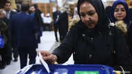 An Iranian woman casts her vote during parliamentary elections at a polling station in Tehran, Iran February 21, 2020. Nazanin…