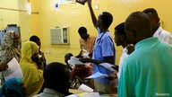 A doctor looks at an X-ray of a victim of violence in the crackdown on Sudanese protesters, inside a ward in a hospital in…