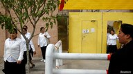 Ethnic Uighur women leave a centre where political education lessons are held in Kashgar, in Xinjiang Uighur Autonomous Region,…