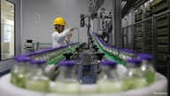 An employee works on a production line manufacturing drugs at the Yangtze River Pharmaceutical Group in Taizhou, Jiangsu…