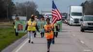 Civil rights activists march down U.S. Route 80 in a reenactment of the historic 54-mile Selma to Montgomery march for voting…