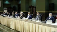 Senior officials wear face masks amid fears of coronavirus disease (COVID-19) as they attend a meeting of the Iranian…