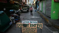 A makeshift barricade blocks a street from outsiders to protect a neighbourhood from the spread of coronavirus disease (COVID…