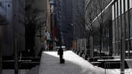 A man walks alone near the World Trade Center in lower Manhattan during the outbreak of the coronavirus disease (COVID-19) in…