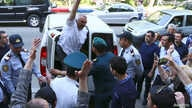 Azerbaijani Journalist Afgan Mukhtarli greets supporters as he is taken to the court in Baku, Azerbaijan, May 31, 2017. REUTERS…