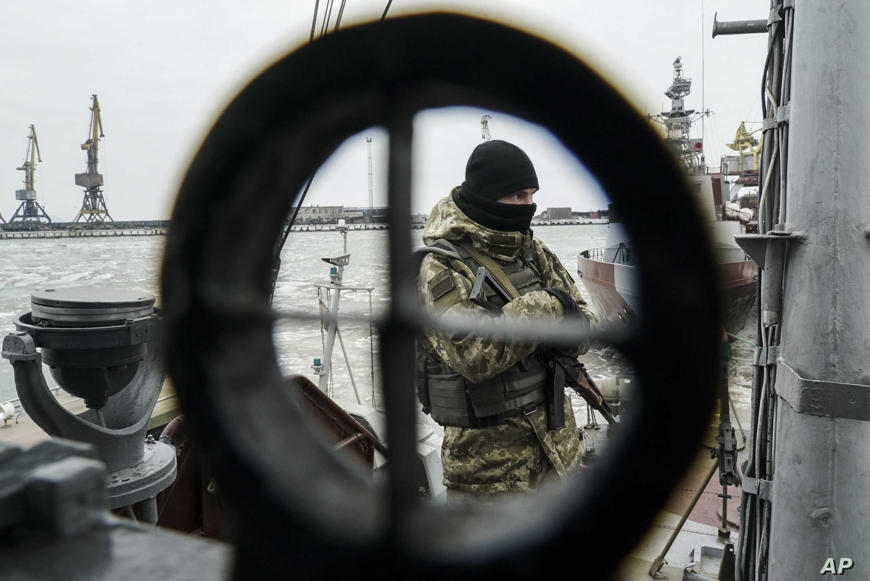 FILE - A Ukrainian serviceman stands on board a coast guard ship in the Sea of Azov port of Mariupol, eastern Ukraine, Dec. 3, 2018.