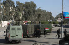 Egyptian riot policemen surround the entrance of al-Azhar university during clashes with students who support the Muslim Brotherhood, in Cairo's eastern Nasr City district on December 27, 2013.