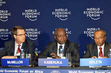 President of the African Development Bank Group Donald Kaberuka (C) addresses a news conference alongside Doug McMillon (L), president and CEO Wal-Mart International (L) and Bekele Geleta, Secretary-General of International Federation of Red Cross an