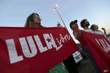 """Supporters of Brazil's former President Luiz Inacio Lula da Silva, display banners saying """"Free Lula"""" in Portuguese during a protest in front of the Superior Electoral Court, Brasilia, Aug. 31, 2018."""