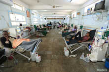 FILE - People with kidney failure undergo dialysis at a hospital in the Red Sea port city of Hodeidah, Yemen Nov. 28, 2018.