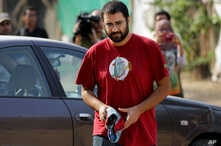 Egypt's most prominent activist Alaa Abdel-Fattah arrives outside a court that convicted 23 activists of staging an illegal demonstration and sentenced them each to three years in jail, in Cairo, Egypt, Oct. 26, 2014.